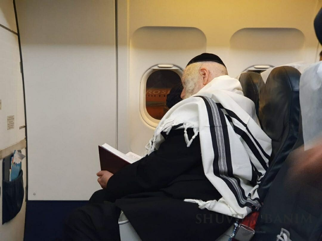 Learning Torah on the flight - no minute is wasted.