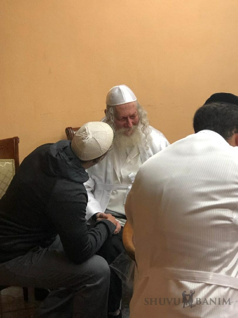Giving blessings and advice in Uman